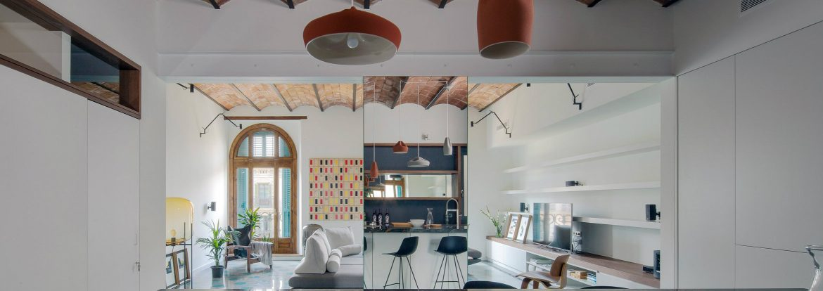 Well-placed mirrors make this small apartment look much bigger